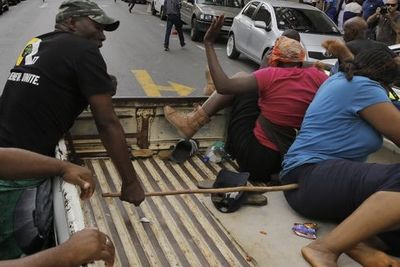 Video: Anc Member Turns Himself In After Kicking An Elderly Woman To The Ground During A Protest