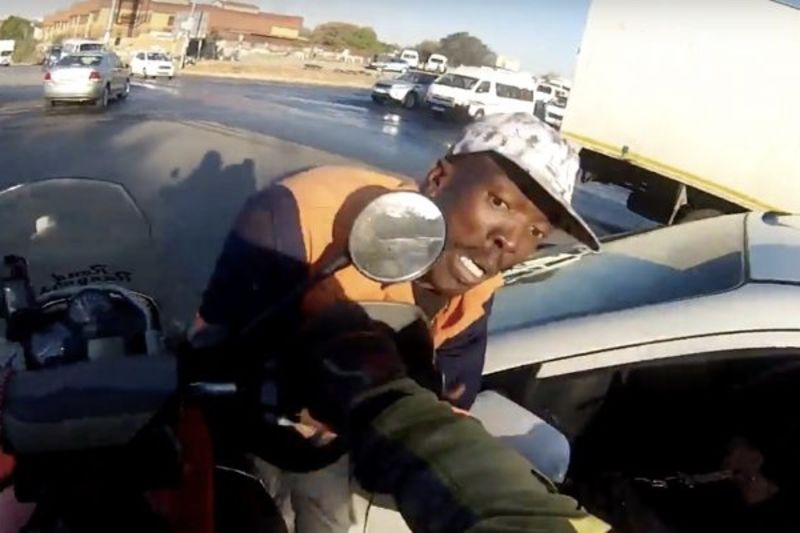 Biker Stops a Smash and Grab – Video Caught on Helmet GoPro 1